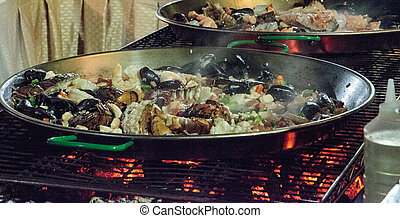 Seafood paella with shrimp, scallops, lobster and muscles,...