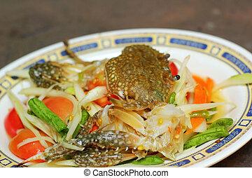 Seafood papayd salad on a plate
