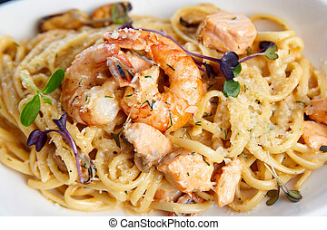 Seafood pasta - Creamy seafood pasta with salmon, shrimp,...
