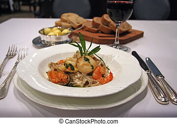 Seafood pasta served in luxury restaurant setting