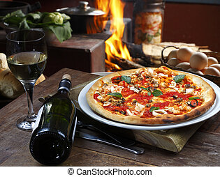 Seafood pizza with white wine