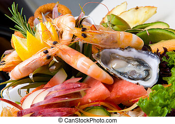Seafood platter served fresh and deep fried surrounded with ...