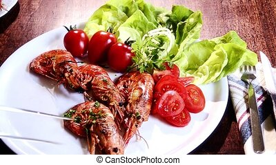 seafood, prawns - shrimp, green salad and tomatoes