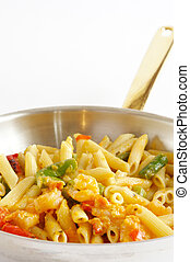 Shrimp Penne Pasta cooked in a stainless steel frying pan