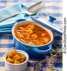 Seafood soup - A small blue cooking pot with a delicious ...