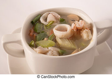 seafood soup in a white cup