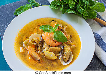 seafood soup with clams, mussel and prawn with vegies