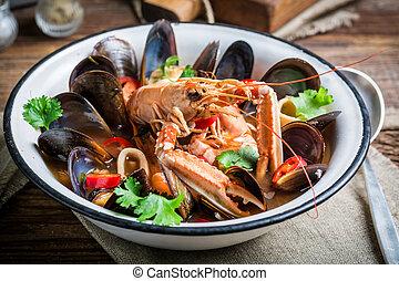 Seafood soup with mix of shellfish
