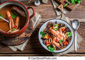 Seafood soup with mussels and langoustines