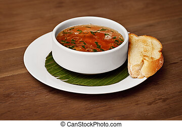 Seafood soup with toasted bread