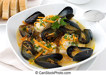 Seafood stew - Haddock and mussel stew in a white plate