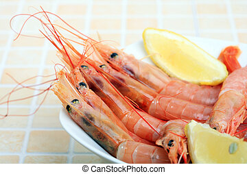 Seafood - white bowl with boiled prawns and lemon slice