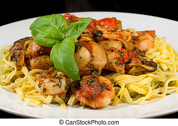Seafood with linguini pasta - A plate of seafood and pasta.