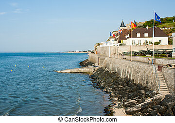 Seafront of Arromanches-les-Bains on the English Channel. ...