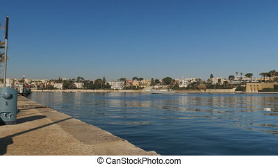 Seafront of Brindisi, with view of the Monument to the...