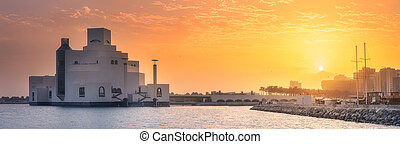 Seafront of Doha park and Museum of Islamic Art during ...