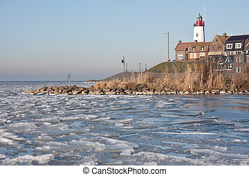 Seafront of Urk from frozen sea in the Netherlands