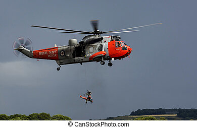 A royal navy rescue helicopter on a training exercise.