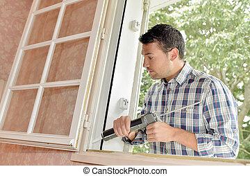 sealant, autour de, cadre, fenêtre, mettre, homme
