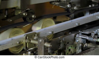 Sealed tin cans with meat are moving further along the conveyor