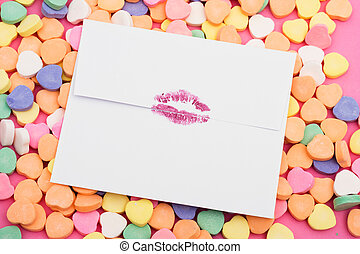 Envelope with lipstick lip prints on a heart background