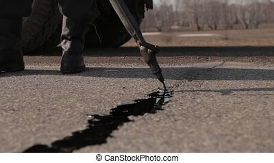 Sealing joint - crack in asphalt