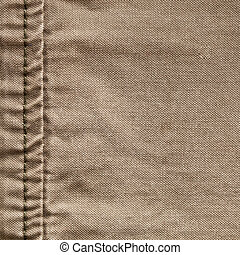 Seam in burlap - Close up of the seam on a khaki color...