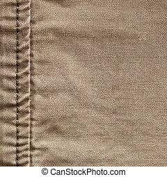 Seam in burlap - Close up of the seam on a khaki color...