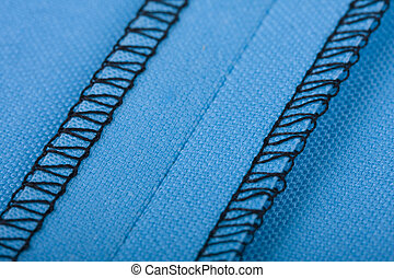 Seam - Macro of a seam in blue woven fabric