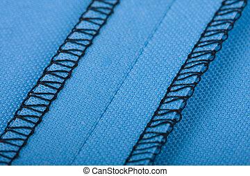Seam - Macro of a seam in blue woven fabric