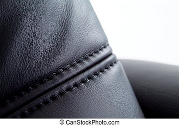 Seam on black leather furniture with white background....