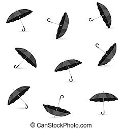 Seamless pattern with realistic black umbrellas