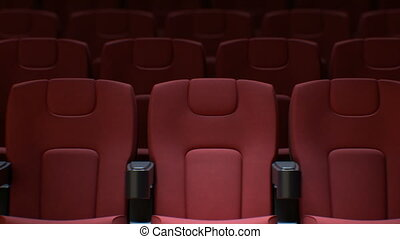 Seamless Red Chairs in Cinema Hall. Looped 3d Animation of...