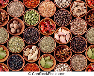 Seamless texture of spices on black background