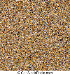 Seamless texture of yellow sea sand.