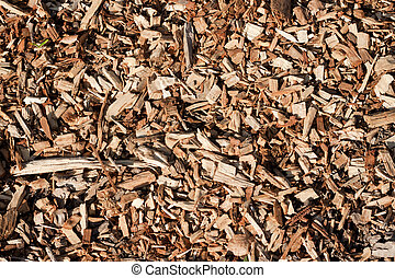Seamless tiling woodchips for landscaping background.