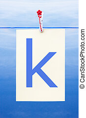 Seamless washing line with paper showing the letter k -...