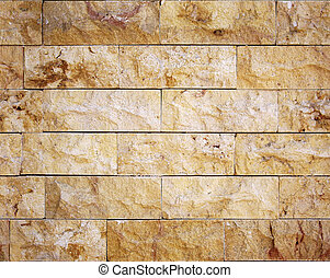 Seamless yellow facing stone masonry texture.