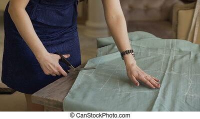 Seamstress and fashion designer at work. Young woman draw...