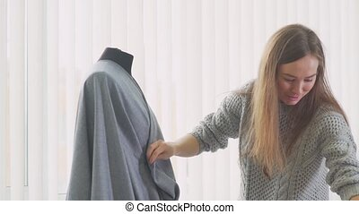 Seamstress clothing stabs safety pins and make the stitches....