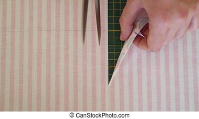Seamstress cutting textile for sew