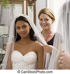 Seamstress helping bride. - Caucasian seamstress helping...