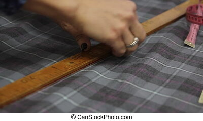 seamstress makes cutting work