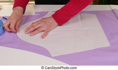 Seamstress Making Clothes Pattern - Dressmaker working in...