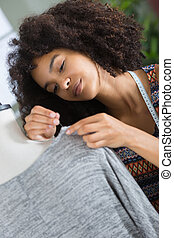 seamstress putting pin on the clothing