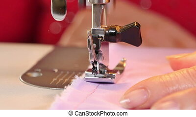 Seamstress Sews Clothes Machine - Tailor sewing in her...