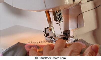 Seamstress Sews Clothes Over Lock - Seamstress Sews Clothes...