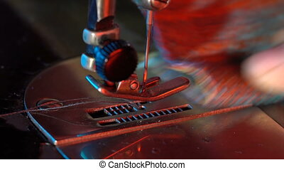Seamstress sews on a sewing machine