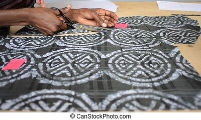 seamstress - tailor cuts the cloth