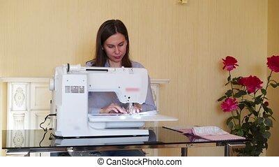 Seamstress working at sewing machine - Seamstress young...